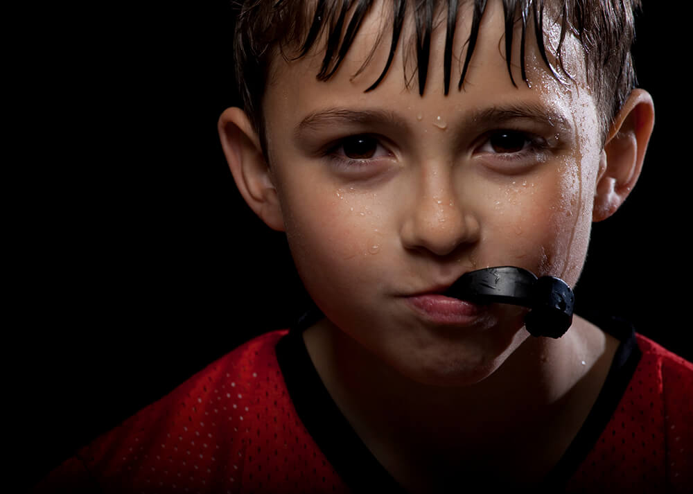 Kid with mouth guard