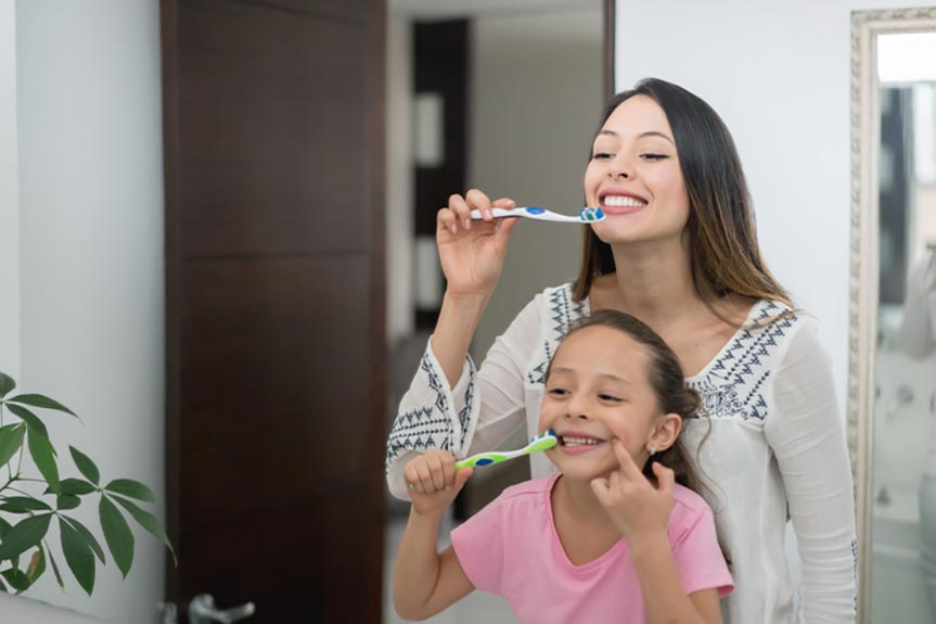brush your teeth with your kids to build a routine