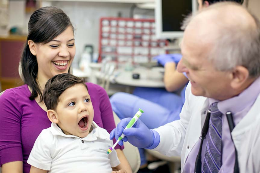 take your child to the dentist twice a year