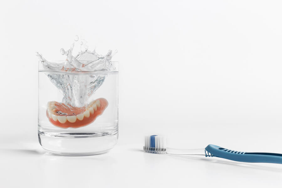 dentures in cleaning solution