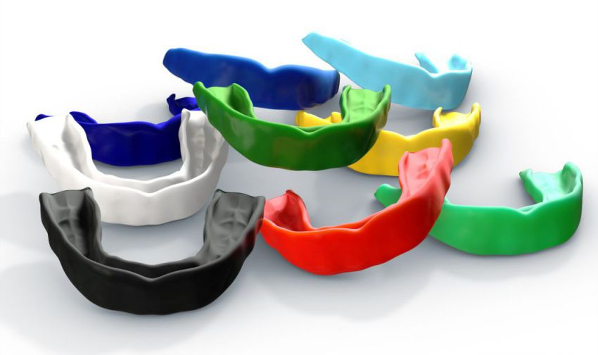 collection of colorful regular moulded sports and night mouthguards